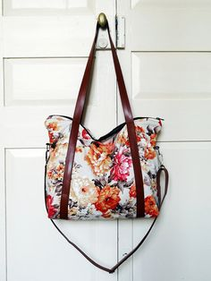 Recycled diaper bag, orange floral curtain, three pockets, adjustable straps