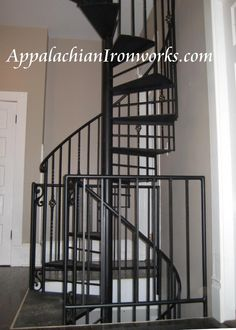 3 story spiral staircase from basement to attic in Mt. Joy Virginia in Bedford.  Custom designed, fabricated, finished, and installed by Appalachian Ironworks