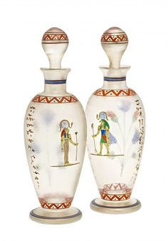 1920's Bohemian art glass perfume bottles and stoppers, clear crystal, crazed iridescent finish, enameled Egyptian motif. 7 3/4 in.