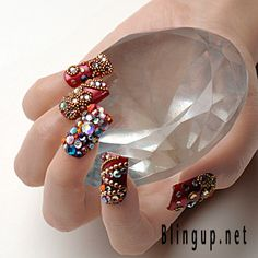 Red-Nail-Arts-with-Flower-Shaped-Beads