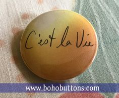 C'est la Vie Pinback Button Positive Thinking by BohoButtonShop yellow and orange french pinback button, magnet, backpack pins, custom pins and patches, travel buttons, social quote button, hippie and bohemian flair, etsy, vegan feminist quote, books author reading pins, boho buttons, sticker decals, world traveler and adventure gear