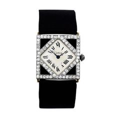 Cartier Lady's Platinum, Diamond and Onyx Wristwatch | From a unique collection of vintage wrist watches at http://www.1stdibs.com/jewelry/watches/wrist-watches/