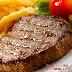 It's too cold outside to grill. Stay in and make this... Grilled Beef Steak with Garlic Butter. Really, this recipe is amazing. Try it. Make it on your George Foreman Grill. I'm not kidding. It's really good.