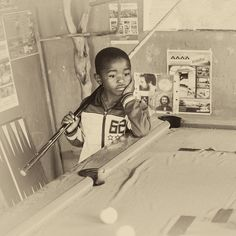 Photographic print of African boy playing pool. Photography For Sale, Travel Photography, Art Prints For Sale, Fine Art Prints, Photo To Art, Pub, Boys Playing, Cool Pools, Artwork Prints
