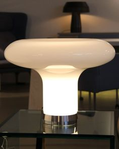 A gorgeous smoked grey Murano glass table lamp. It's a contemporary revision of an original 1967 design by Angelo Mangiarotti, shown here in a modern living room. http://www.italian-lighting-centre.co.uk/modern-murano-glass/lesbo-smoked-murano-glass-table-light-from-artemide-p-8039.html#.VWCLcvlViko