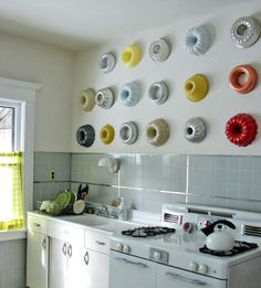 Painted bundt pans on kitchen wall