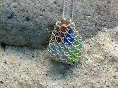 Absolutely LOVE this necklace. Might need to find my sea glass collection for this! Pirates Booty Sea Glass Necklace  Unique Design by OctupusGarden, $59.99