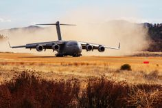 A U.S. Air Force C-17 Globemaster III aircraft lands on Fort Hunter Liggett, Calif., Jan. 31, 2014. This landing was part of a Air Force operation to test fire the M142 High Mobility Artillery Rocket System, (HIMARS). (U.S. Army photo by Private 1st Class Nathaniel Newkirk)