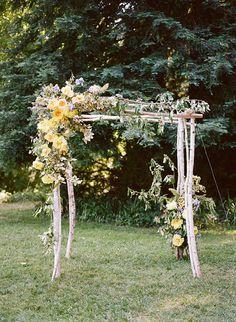 Yellow peony birch wedding ceremony arch by shotgun floral studio, photo: christina mcneill