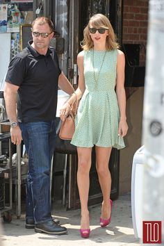 Taylor Swift seen leaving the gym in New York City in a sleeveless dress paired with Christian Louboutin pumps and a Tod's tote.