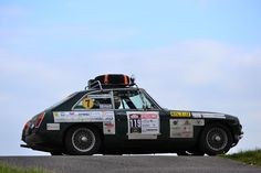 An early British version of the MGB GT during a car Rally. That's a lot of stickers!