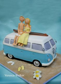 Adorable VW Bus-shaped wedding cake with fondant figurines.