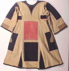 Jibbah, the basic uniform worn by soldiers of the Mahdi Dervish army in Egypt and the Sudan in 1885 - 1886. It is a simple, cotton smock, with coloured patches. This one was brought back as a trophy by a British officer. The uniform of the Dervishes was based on the Madhi's clothes. The red and blue patches were originally a symbol of poverty and asceticism.