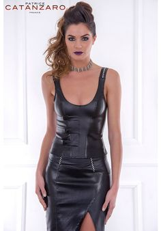 Holographic details on side in patent leather body comes in this sexy top done with fastener details on one shoulder straps, straps with button closure finish.