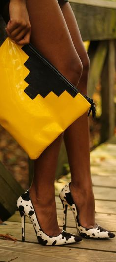 Match killer vertiginous heels in cowhide print with a brightly coloured clutch for a striking look | Image via lolobu.com