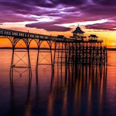 """Clevedon Pier in Somerset, described by Sir John Betjeman as """"The most beautiful pier in England"""". Opened in 1869 to receive paddle steamer passengers from Devon and Wales. Nowadays it still hosts boat trips but is also home to a number of events as well as a gift shop, cafe and visitor centre detailing the history of the pier and the local area. Thanks for sharing @jongodfreyphotos  #VisitEngland #seasidesecrets #traveltuesday Places To Travel, Places To See, Images Of England, Over The Bridge, Beautiful Beaches, Beautiful Scenery, British Isles, Landscape Photography, The Good Place"""