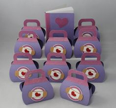 Doc McStuffins Party Favors...bet i can find purple bags, sticker band aids and hearts for much cheaper!