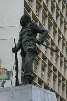 This statue commemorates Dedan Kimathi. He led the Mau Mau uprising against the British colonialists in Kenya. The statue now stands in Nairobi 's city center and depicts him in military fatigues. He holds a rifle an a dagger. The statue is an official acknowledgment that the Mau Mau & Kimathi were instrumental in Kenya 's struggle to gain independence from the British.