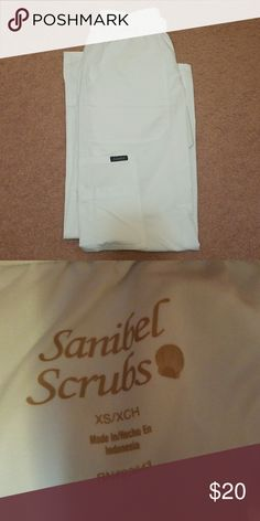 Sanibel Scrub Pants Size XS. New without tags never worn. In white have 2 available. Purchased for a job then didn't need them. Perfect for those nursing students! Very soft material with lots of pockets to keep pens in Sanibel Pants