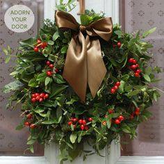 Beautiful Natural Christmas Wreath Composed Of Green Leaves And Red Berries With A Large Brown Ribbon