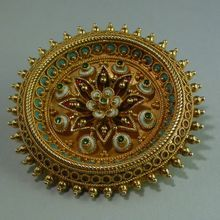 Victorian Etruscan revival enamel 18-carat gold brooch. I would wear this everywhere. It would look breath taking against black.