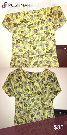 A fun shirt for a day at the office or a night out This shirt is an easy shirt to go from office to a night out. Short sleeve. Beautiful colors!! Gold buttons down front of shirt for decoration. Dana Buchman Tops Blouses