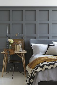 Chic bedroom, love the color, textures and patterns on the bedding & the charcoal wall detail. #grey#trend#bedroom