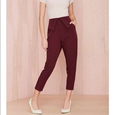 #209 nasty gal You gotta know when to fold, ladies. Our Fold Ya So Trousers have a tapered silhouette with pleat detail, pockets, and fold-over design at the waist. Unlined, back zip closure. Pair it with platform oxfords and a plaid turtle neck. Made in L.A. by Nasty Gal. *Polyester/Viscose/Spandex  *Runs true to size  *Model is wearing smallest size available  *Machine Wash Cold  *Made in USA Nasty Gal Pants Trousers
