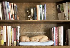 Newborn photography on a bookshelf. Great baby picture idea! Use all his children's books for this.