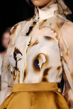"""Giles #LFW. """"In South African townships the i'khothane craze got teenagers burning designer clothes. They do it to prove that they're so rich that expensive possessions mean nothing."""""""