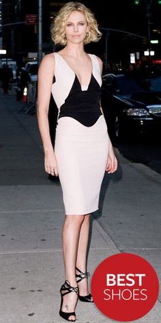 Charlize Theron  WHAT SHE WORE  Outside New York's Ed Sullivan Theater, Theron worked black Tom Ford lace-ups with a plunging Antonio Berardi sheath
