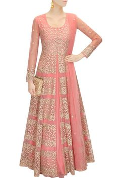 This coral pink lehenga is featuring in net with floral zari embroidery all over. This coral pink lehenga comes along with matching floral motif net dupatta. This outfit is inspired by Aneesh Aggarwal
