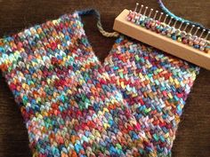 Figure eight stitch on an Authentic Knitting Board Tadpole loom. Creates a lovey double sided fabric - cross stitch on one side and stockinette on the other.  The yarn is Misty Alpaca Hand Painted Chunky in Pico.