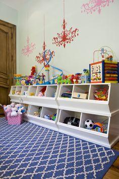 white storage bins, blue rug, pink bin