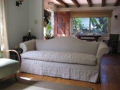 Linen slipcover on camelback sofa