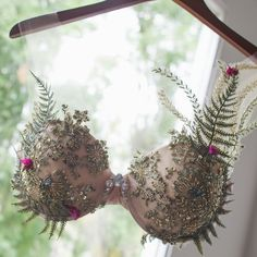 Lace and ferns appear to effortlessly wrap your body accented with rhinestone details and pops of purple flowers. As featured on beautiful