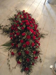 Funeral Flowers. Red rose coffin spray, funeral flowers www.thefloralartstudio.co.uk