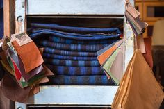 Piles of antique blue and black Dutch cloth in our shop!