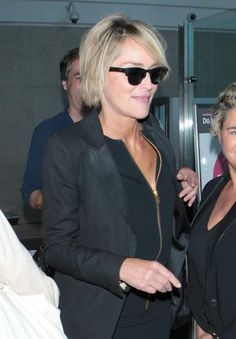 photo Sharon Stone wearing a black suit and spiked heels April 13-2015 004_zpsbnb5ysvz.jpg