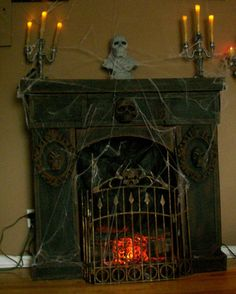 Cardboard fireplace with Dollar Store items . http://www.halloweenforum.com/members/theundeadofnight.html http://theundeadofnight.wix.com/theundeadofnight