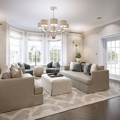 The relaxing family living room at our Surrey project with soft tactile fabrics…