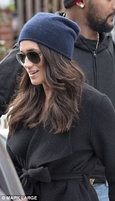 Happy to be seen: Markle left her home in a leafy Toronto neighborhood, the first time she has been seen in public since the