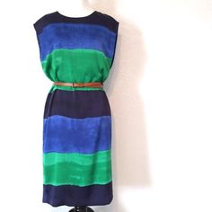 HP | Anne Klein Blue & Green Shift Dress Beautiful shift dress in shades of blue and green by Anne Klein. This dress originally came with a green fabric belt that was missing  when I purshased it (belt shown is my own). Back zipper, fully lined. 100% polyester. Excellent NWT condition. Size 4 Anne Klein Dresses