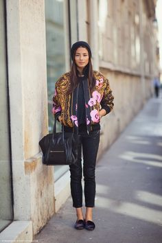 Jessica Gomes amazingly perfect in a Givenchy jacket over the all black outfit, a Celine python black bag and velvet sleepers.