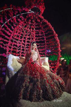 Gorgeous bridal entry with roses for wedding. See more on wedmegood.com  #wedmegood #indianwedding #indianbride #roses #portraits #jewellery #bridallehenga #lehenga #lehengacholi #entryway
