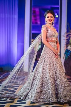 Looking for Cocktail or sangeet lehenga with cape dupatta? Browse of latest bridal photos, lehenga & jewelry designs, decor ideas, etc. Indian Wedding Gowns, Indian Gowns Dresses, Indian Bridal Outfits, Indian Bridal Wear, Indian Fashion Dresses, Indian Designer Outfits, Bridal Dresses, Designer Dresses, Fashion Blouses