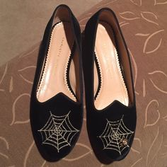 Charolette Olympia Spider Web Flats Black stitched spider web flats. Spider is a Swarovski crystal and the web is stitched Great condition, but my left heel rubs on the back of the shoe and it hurts. Would trade for a different size. negotiable Charlotte Olympia Shoes Flats & Loafers