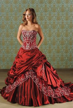 I hear red wedding dresses are a thing now. I don't know about that, but there's still something fabulous about this one.