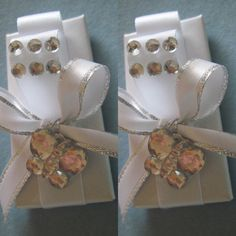 Set of 12 Long shaped chocolates wrapped in white color paper wrap, decorated with white and silver satin ribbon, fake Crystal jewels and fake Crystal butterfly. A great favor for baby shower, welcome baby, baptism, first communion and even great to be placed in the center of a dinner plate at a wedding reception. In person delivery is available for local customers. Price is for set of 12 pieces of chocolate favors. For multiple designs order please contact us to arrange a package reserved…