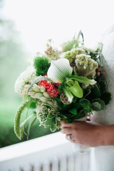 Spectacular white orchids surrounded by a canopy of coral and white for Lyndsay's bridal bouquet at her Audubon wedding - by Buttercup: Off BEET Productions Photography.